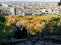 A_couple_sitting_on_top_of_Mount-royal_looking_at_Montreal_.jpg